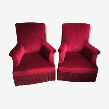 Paire de fauteuils en velours grenat