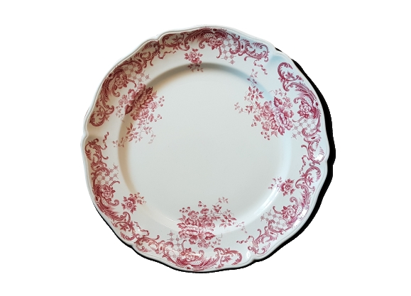 Assiette en faïence ancienne à décor de couronne de fleurs