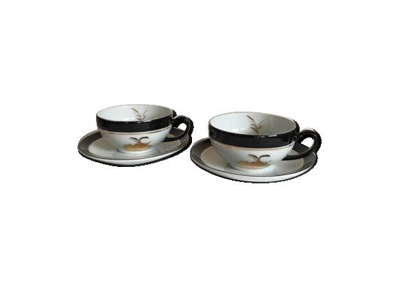 Tasses porcelaine blanches et noires