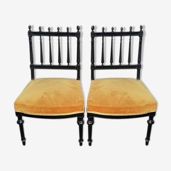 Paire de chaises basses en bois noirci Napoléon III