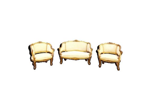 Salon de style Louis XV en bois doré deux bergères et un canapé