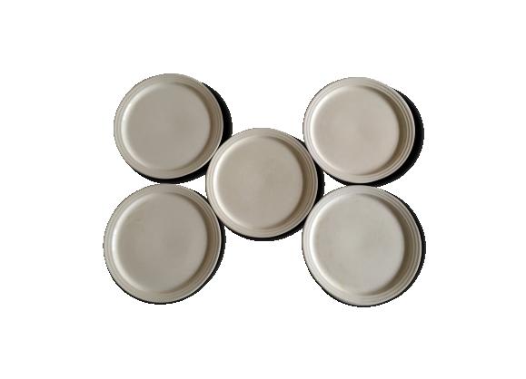 Service d'assiettes plates en faience pâte ivoire art déco