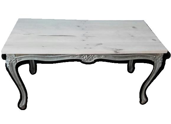 Jolie table basse, pieds en volutes et plateau en bois.