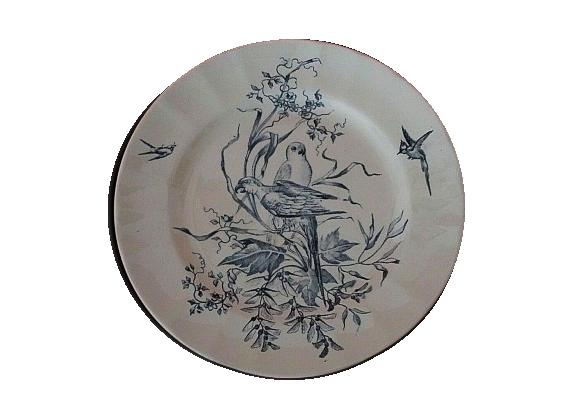 Assiette en faïence Longchamp terre de fer modèle Congo décor perruches